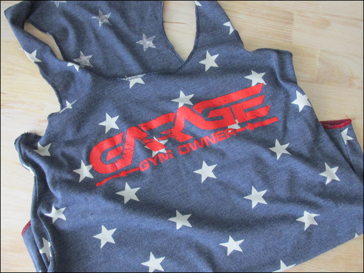 Proudly represent your garage gym, your pride, and your toned arms while supporting garage-gyms.com and helping to fund future reviews