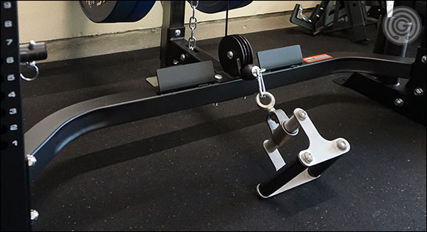 The rear stabilizer is out of the way of your feet for squats, bench for pressing, and has foot plates for rowing