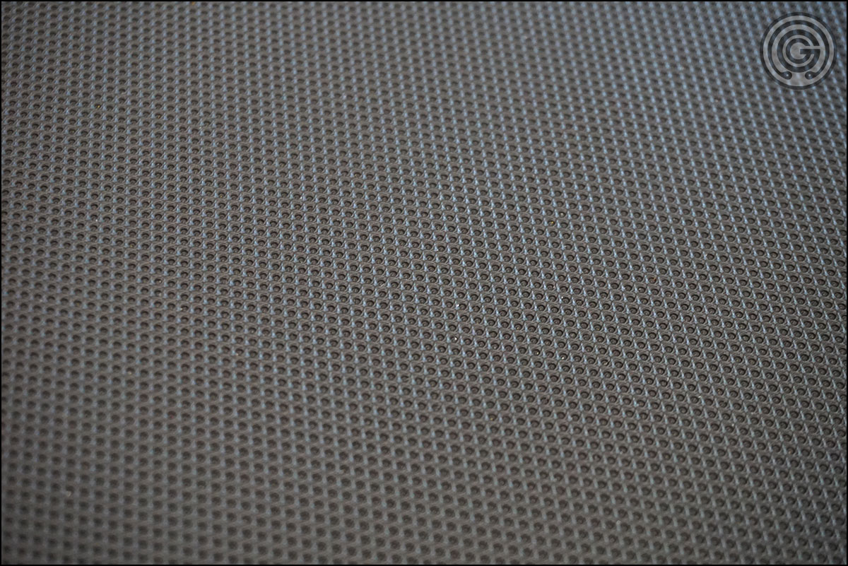 Grippy vinyl texture of the Rep FB-5000 Competition Bench Pad