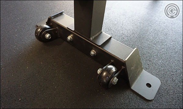 Rep Fitness FB-5000 Competition Flat Bench - wheels for easy mobility (beats picking the whole thing up.)