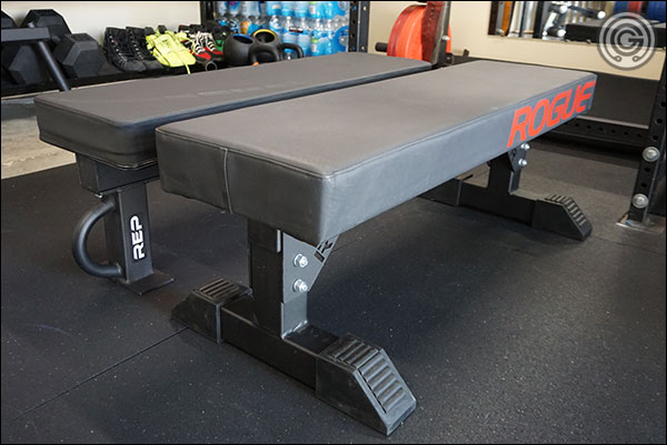"Rep FB-5000 with Wide Pad next to a ""shorty"" Monster Utility Bench with Thompson Fat Pad"