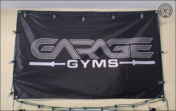 The Garage Gyms gym banner with a knurled design is now available for purchase at the Garage Gyms Store