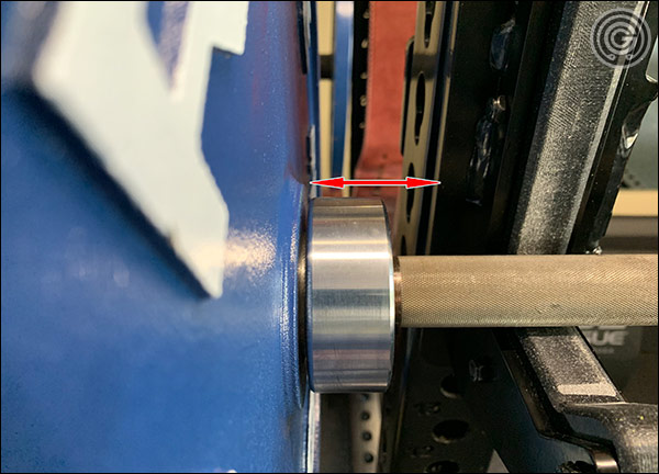 """The plates are awfully close to the upright and J-cup on 49"""" wide racks. Any lateral movement when walking out can result in plates clipping the rack"""