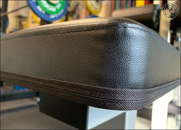 Double-stitched, Durafirm Vinyl seat of the Body Solid Lat & Mid Row Tower - Very nicely done