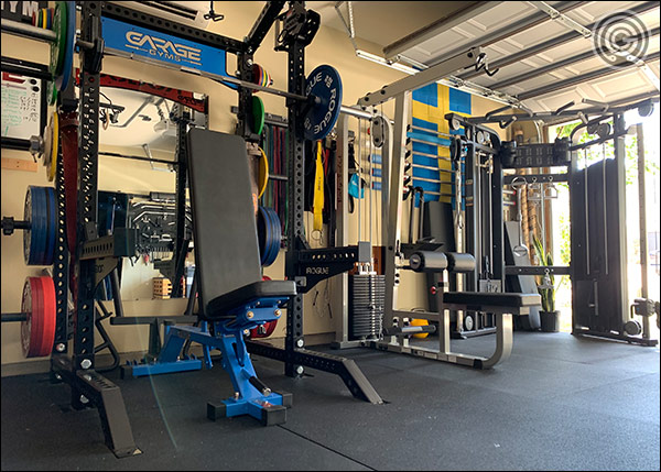 A Monster Collegiate Half Rack, the SLM300G, and a Rep Fitness Functional Trainer side-by-side