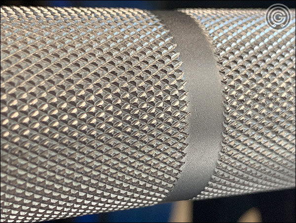 Close up of the Fringe Sport Hybrid Barbell outer knurling
