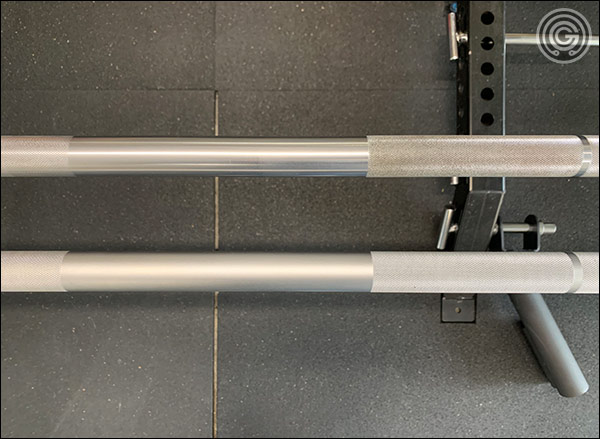 "Like the Matt Chan Bar (top), the Hybrid Bar has the start points of the outer knurling set further out (to protect the shins.) The distance between these two starting points is the same on both bars; 21""."
