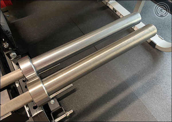 The American Barbell Elite Power Bar's chrome sleeves (top) vs the Deep Knurl Power Bar EX's stainless sleeves