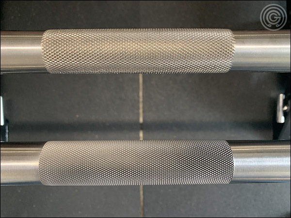 Rogue Ohio Power Bar center knurling (top) versus that of the Rep Deep Knurl