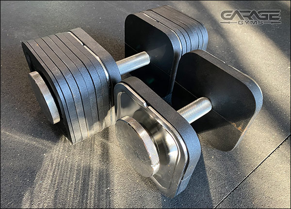 Ironmaster Dumbbells with Heavy Handle Kit - 90-lb dumbbell next to 20-lb dumbbell