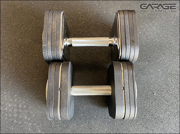Both of these weigh 50-lbs, but the dumbbell with the Heavy Handle Kit is more compact